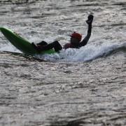 Bellyak sitting on kayak