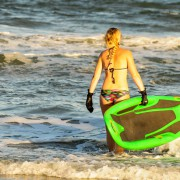 Lauren at the ocean with her Bellyak
