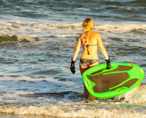 Lauren at the ocean with her Bellyak