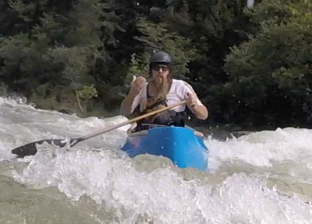 Eli Helbert showing me on my bellyak the way down the river