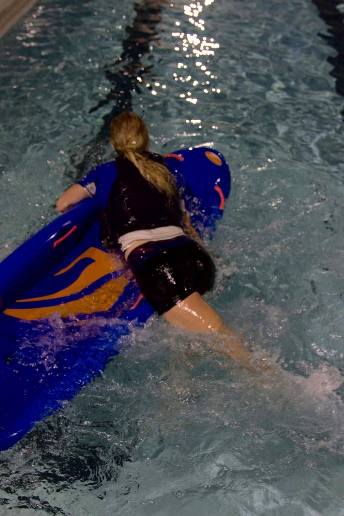 As boat is brought around upright, a quick scissor kick helps with the momentum of the roll