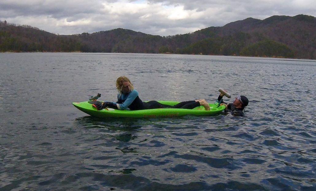 Bellyak serving as a rest station for an open water swimmer